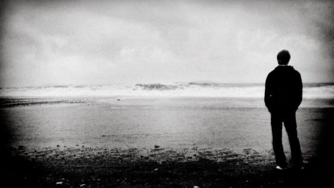 man alone on beach
