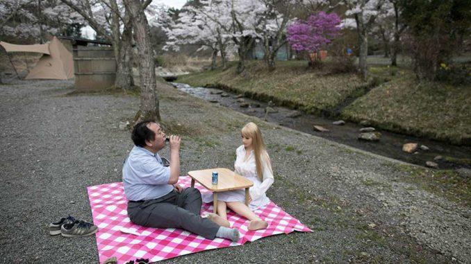 man having picnic with sex robot